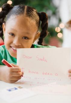 226613-236x342-girl-writing-letter-to-Santa